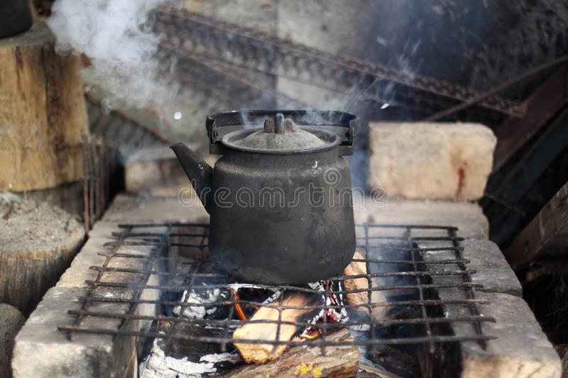 The teakettle on the fire. Boiling teakettle on the fire stock images