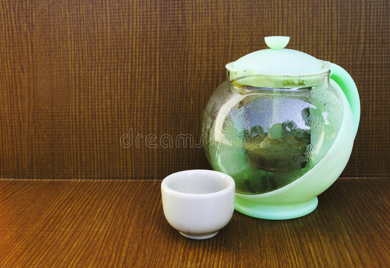 Teakettle and teacup 2. Image of teakettle and teacup.teakettle made from plastic and glass stock photo