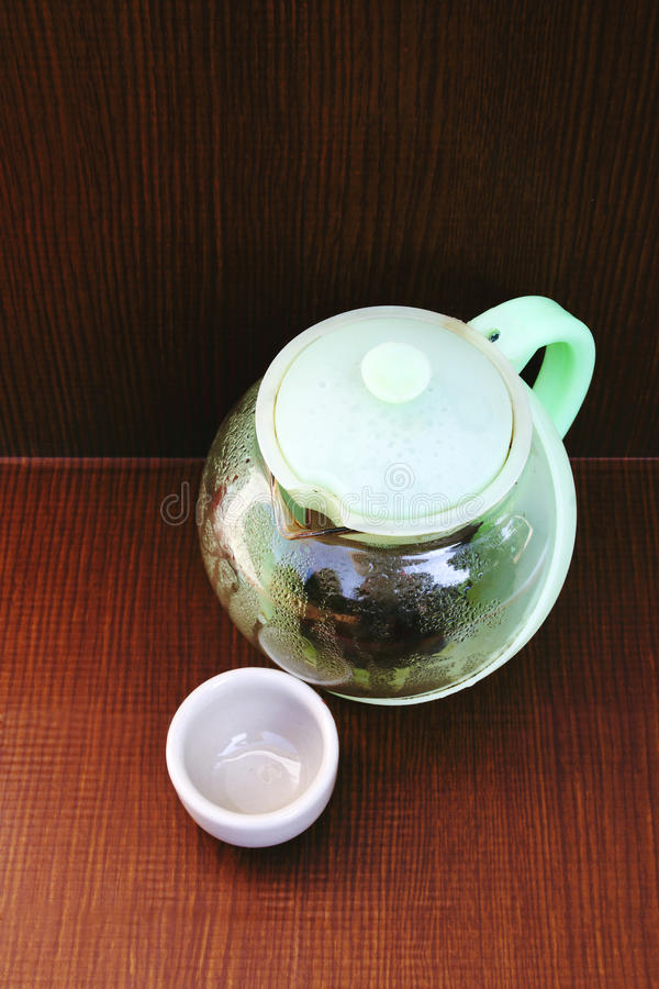 Teakettle and teacup 3. Image of teakettle and teacup.teakettle made from plastic and glass stock image