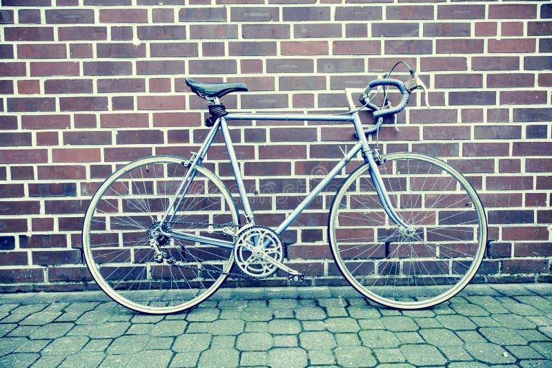 Teal And Black Road Bike Near Black And Brown Brick Wall Free Public Domain Cc0 Image