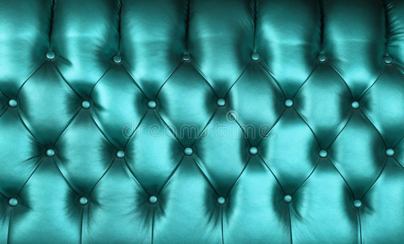 Teal blue leather capitone background texture stock image