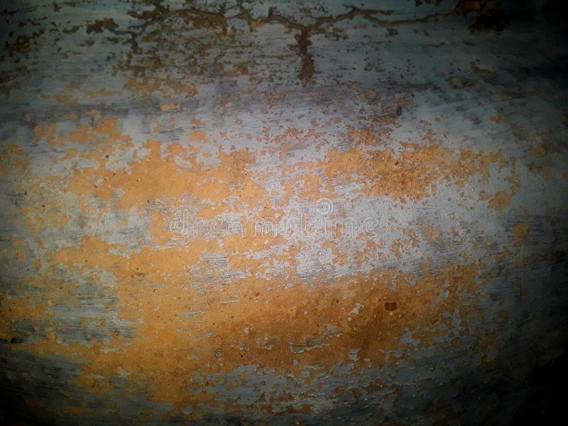 Teal blue and ochre orange stone detail background stock image