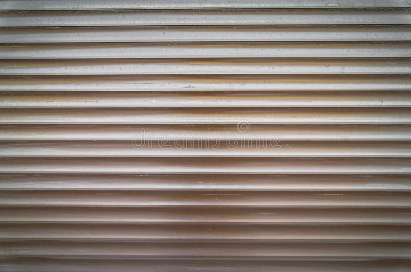 Teal brown painted horizontal metal window roller shutter blinds or garage doors background texture royalty free stock photos