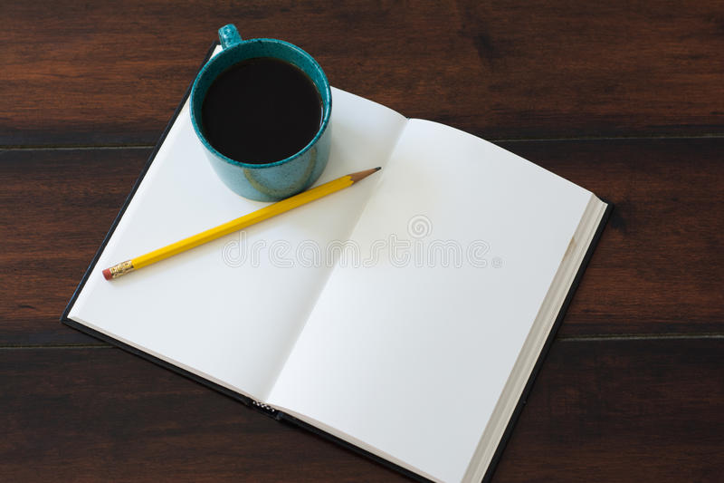 Teal coffee cup full of black coffee stock images