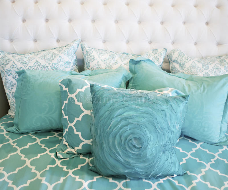 Teal cushions and bedding textiles. Close up of bautiful teal cushions and bedding textiles stock images