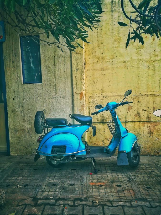 Teal Motor Scooter on Road stock image