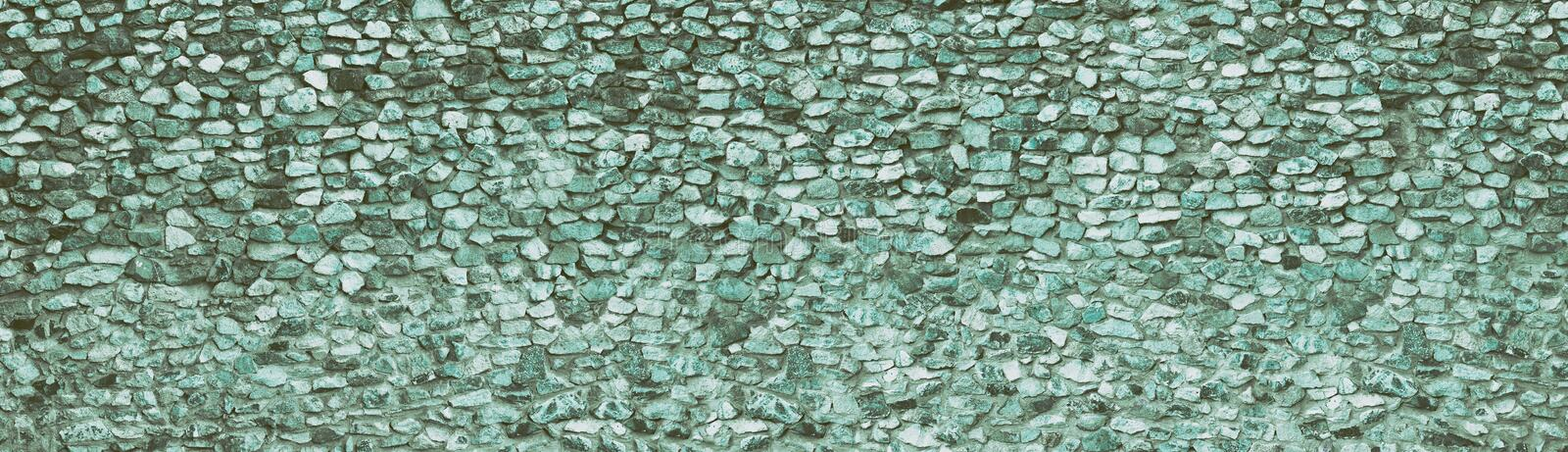 Teal natural stone wide texture. Rough rock panoramic retro background. Long vintage backdrop. Teal natural stone wall wide texture. Rough rock panoramic retro stock photos