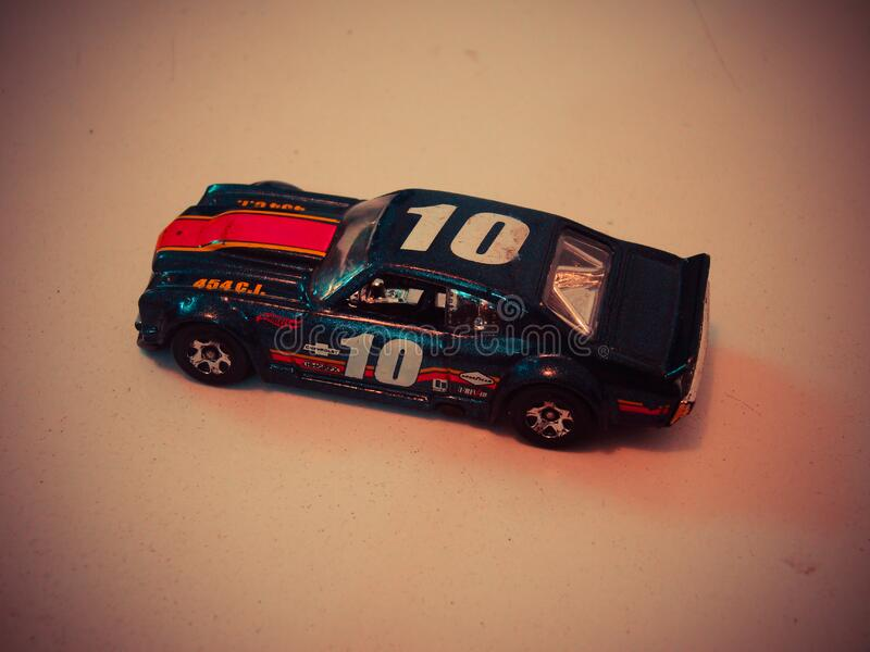 Teal Red and White Die Cast Model of Racing Car stock image