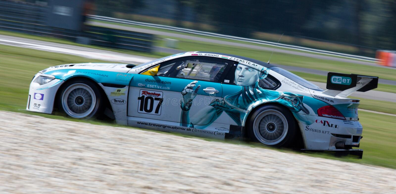 Teal and White Stock Car on Road during Daytime royalty free stock image