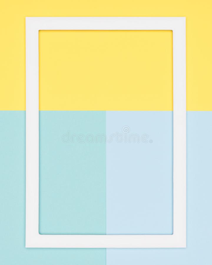 Teal and yellow paper flat lay background. Minimalism, geometry and symmetry template with empty picture frame mock up. Abstract geometrical pastel blue, teal royalty free stock photos