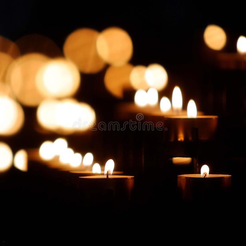 Tealight Candle Lit Up royalty free stock image
