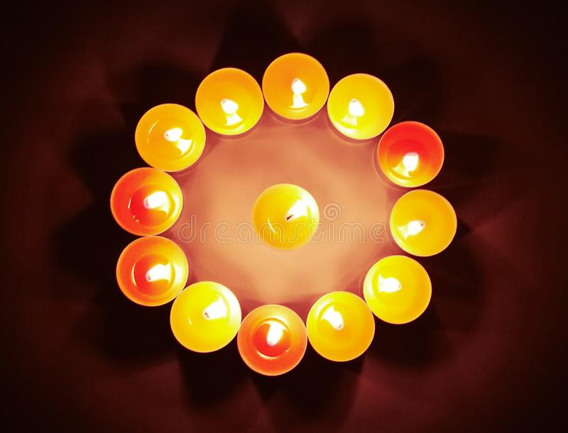 Tealight candles with blurred dark background. Concept for ritual, faith and religion royalty free stock images