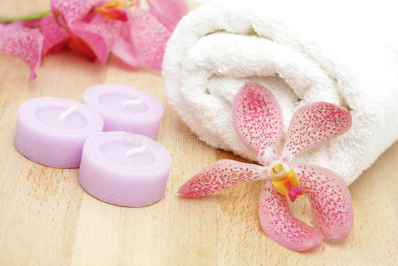 Tealight candles and white towel. With orchids stock image