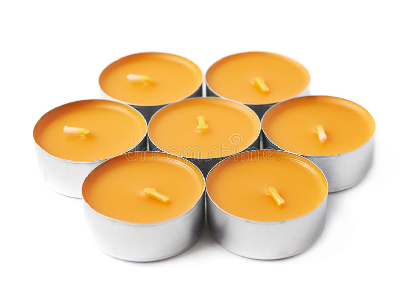 Tealight paraffin wax candle isolated. Pile of tealight paraffin wax orange candles isolated over the white background stock photography