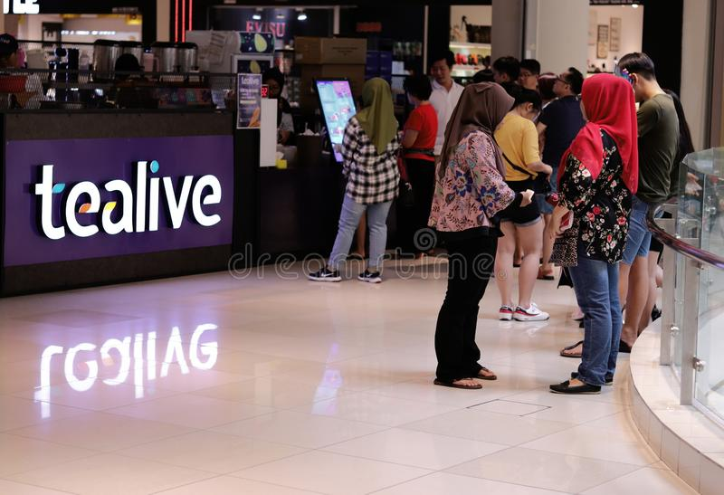 Tealive Bubble Tea Outlet At The Ipoh Parade Shopping Mall. A large crowd queueing up for their fix at the Tealive, previously Chatime, outlet at the Ipoh Parade stock image