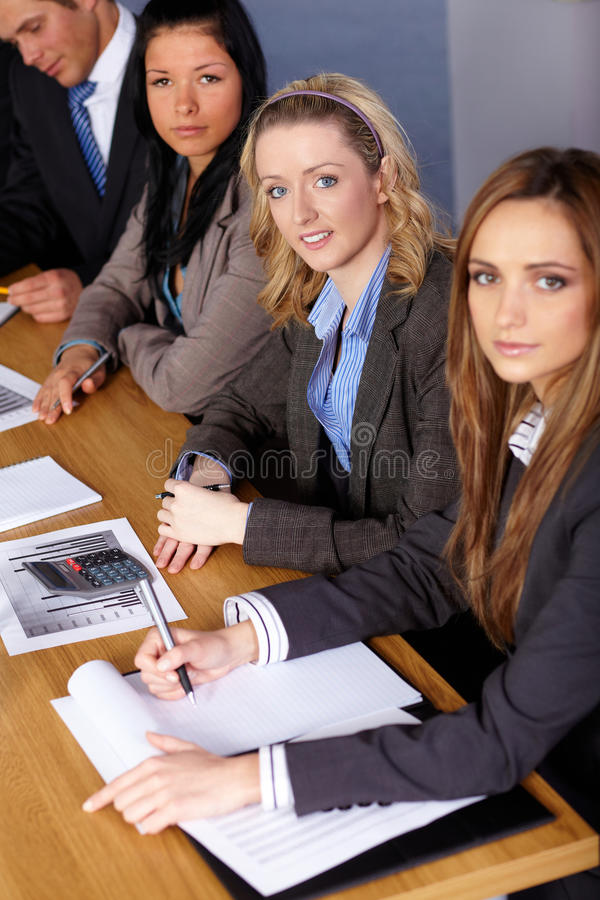 Team of 4 business people working on calculations stock photos