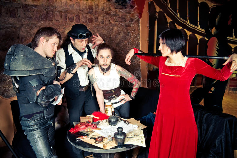 A team of adventurers. Is making plans, at the taverns table royalty free stock image