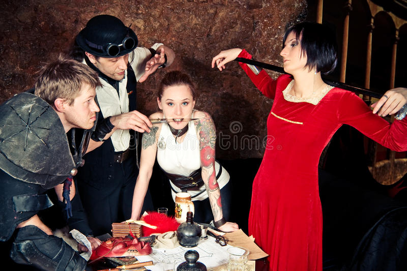 A team of adventurers. Is making plans at the taverns table royalty free stock photos