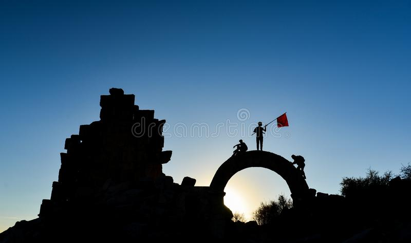 Team of adventurers exploring ruins. A group of adventurers exploring a ruin stock images