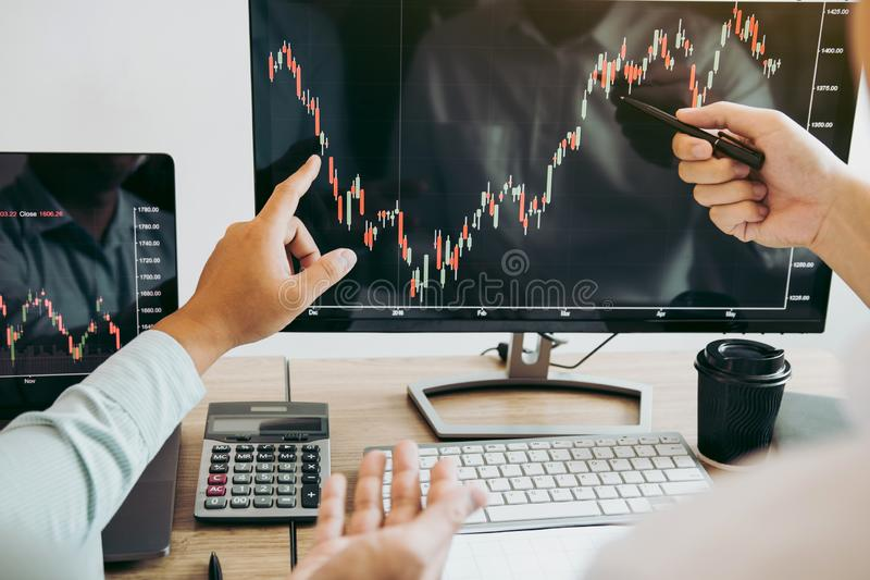 Team of agent trading business people pointing graph and analysis stock market on computer screen in office.  stock images