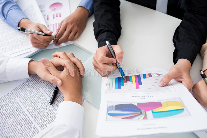 Team of analysts. Close-up shot of an analytical team working with the latest financial results royalty free stock image