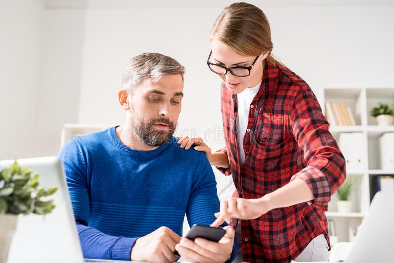 Team of app developers testing new application royalty free stock photos