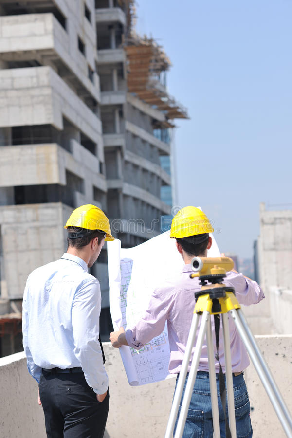 Download Team Of Architects On Construciton Site Stock Image - Image of businesspeople, looking: 21690895