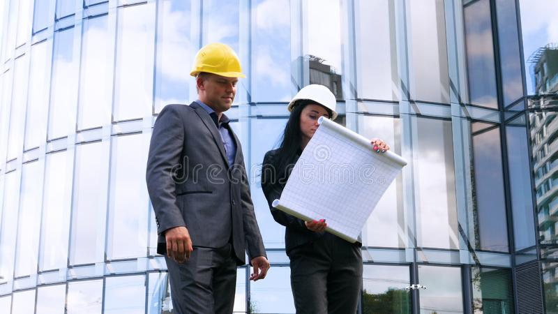 Team of architects and engineer in group on construciton site check documents and business workflow. Engineer inspection in workpl royalty free stock photo
