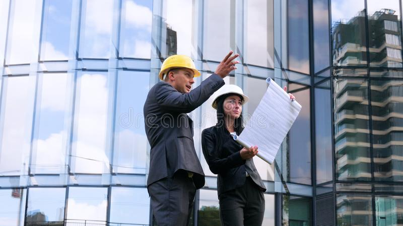 Team of architects and engineer in group on construciton site check documents and business workflow. Engineer inspection in workpl. Ace for architectural plan royalty free stock image