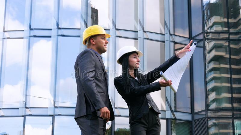 Team of architects and engineer in group on construciton site check documents and business workflow. Engineer inspection in workpl. Ace for architectural plan stock photos