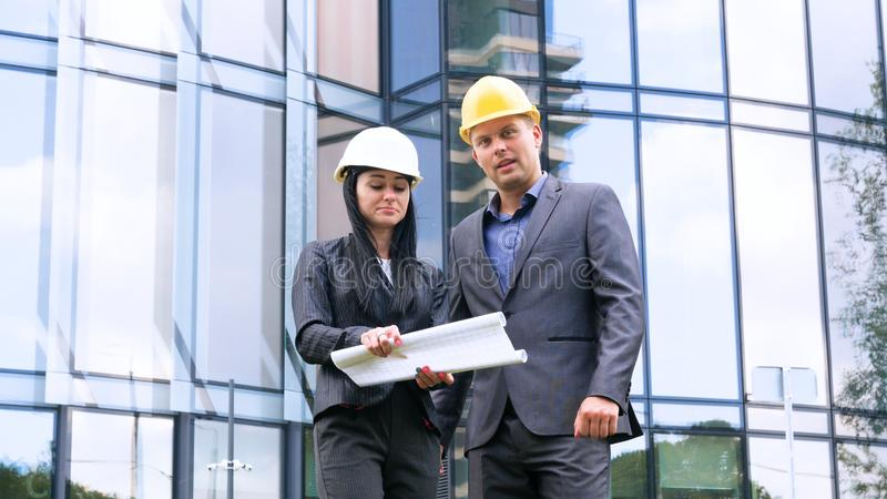 Team of architects and engineer in group on construciton site check documents and business workflow. Engineer inspection in workpl. Ace for architectural plan royalty free stock photography