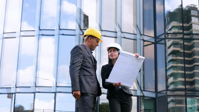 Team of architects and engineer in group on construciton site check documents and business workflow. Engineer inspection in workpl. Ace for architectural plan stock images