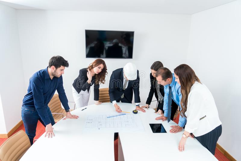 Team of architects presenting construction project. Engineers an royalty free stock photo