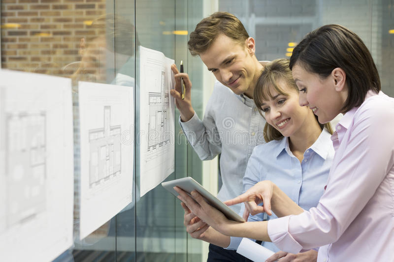 Team of architects working in office on construction project stock photos