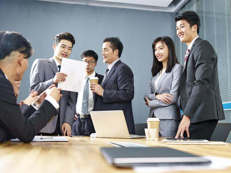 Team of asian business people working together in office stock images