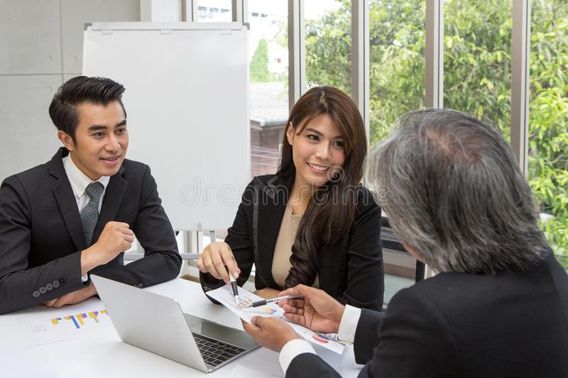 Team of asian business posing in meeting room. Working brainstorming at spacious board room at the office. asian people at office. stock photo