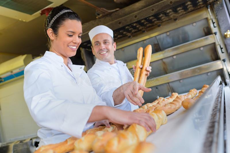 Team bakers working at bakery. Team of bakers working at the bakery stock photo