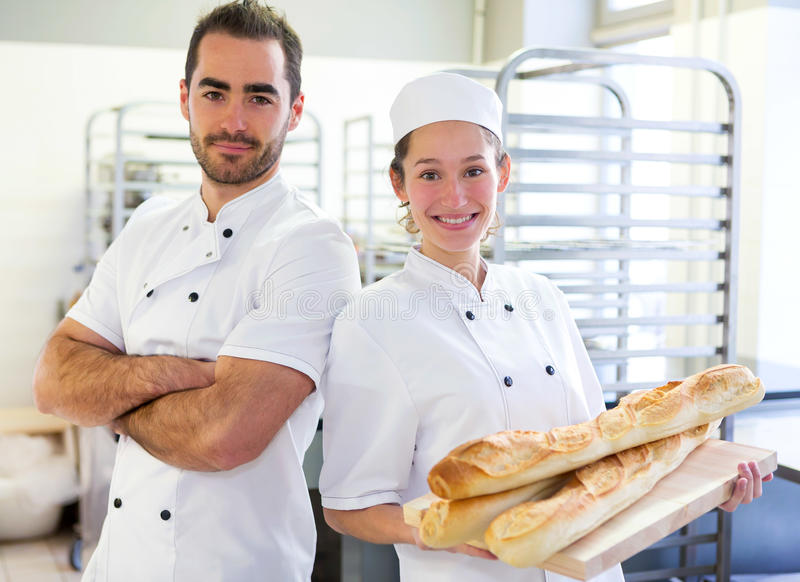 Team of bakers working at the bakery royalty free stock image