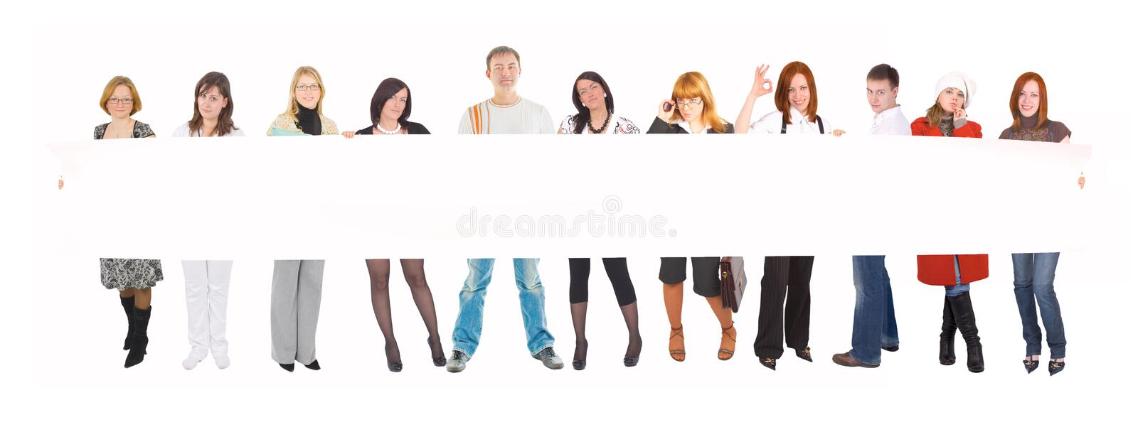 Team with a blank poster. Isolated on white background royalty free stock photos