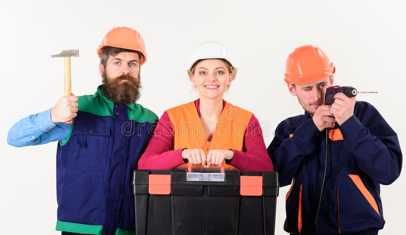 Team of builder, repairman, handyman with toolbox, hammer, drill royalty free stock image