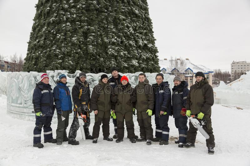Team of builders of assemblers of the ice town stock photo