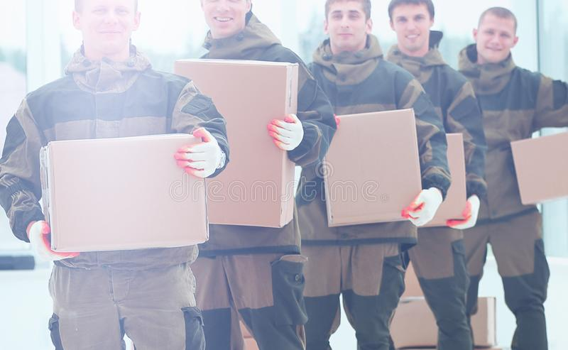 Team of builders with boxes of building materials royalty free stock photo