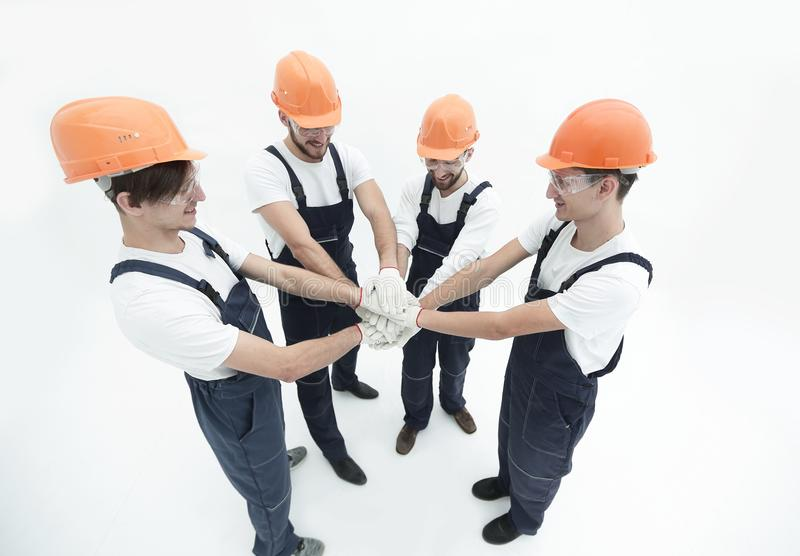 Team of builders showing their solidarity royalty free stock photos