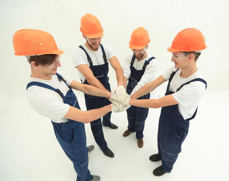 Team of builders showing their solidarity royalty free stock images