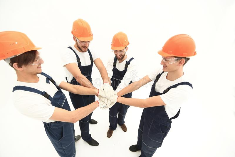 Team of builders showing their solidarity stock image