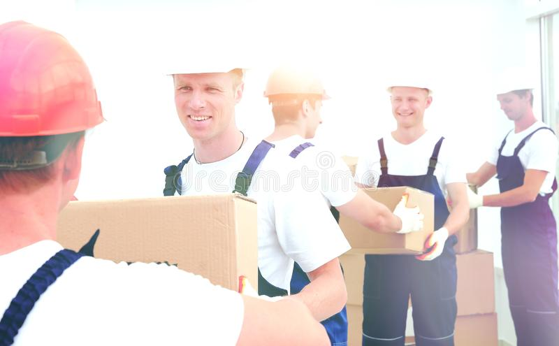 Team of builders to unload materials royalty free stock photo