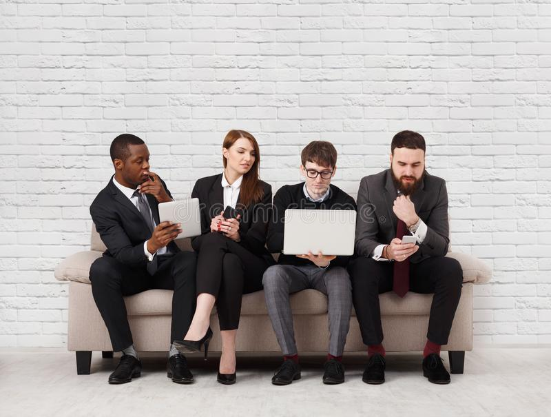Team building, multiethnic team sitting on meeting royalty free stock images