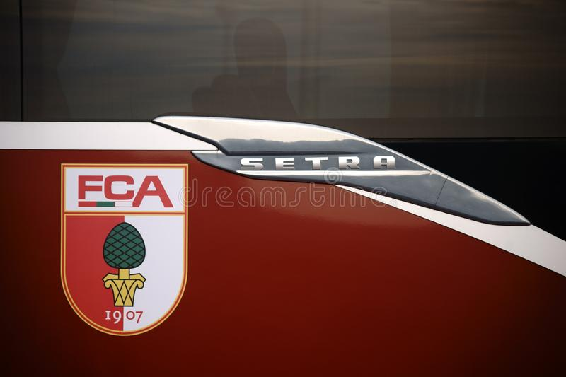 Team bus FC Augsburg. Taunusstein-Wehen, Germany - October 07, 2018: The coat of arms of football club FC Augsburg on team bus at a game of junior national stock photo