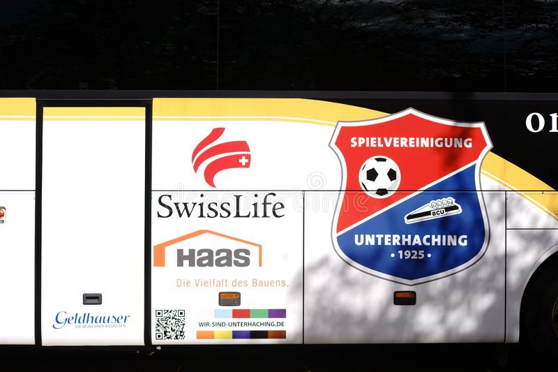 Team bus Spielvereinigung Unterhaching. Nieder-Olm, Germany - September 15, 2018: The coat of arms of the football club Spielvereinigung Unterhaching on the team stock photos