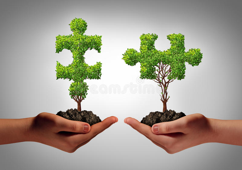 Team Business. Team collaborate business concept with two human hands holding trees shaped as a jigsaw puzzle coming together as a success metaphor for growing